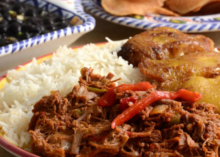 carribean food on colorful plates