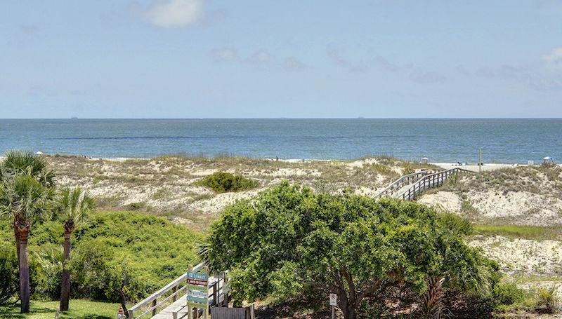 beach boardwalk over dunes in tybee island